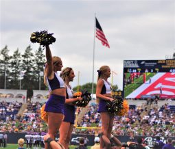Pirate cheerleaders lend their support as Old Glory flies at Navy-Marine Corps Memorial Stadium