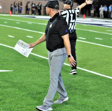 Pirates coach Mike Houston returns to the sideline after calling a timeout. (Photo by Al Myatt)