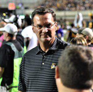ECU athletic director Jon Gilbert was on the sideline during the Thursday night game on ESPN. (Photo by Al Myatt)