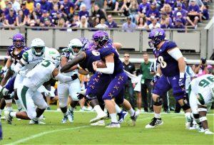 ECU quarterback Holton Ahlers looks for running room at Homecoming. (Photo by Al Myatt)