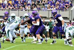 ECU quarterback Holton Ahlers looks for running room at Homecoming. (Photo by Al Myatt)