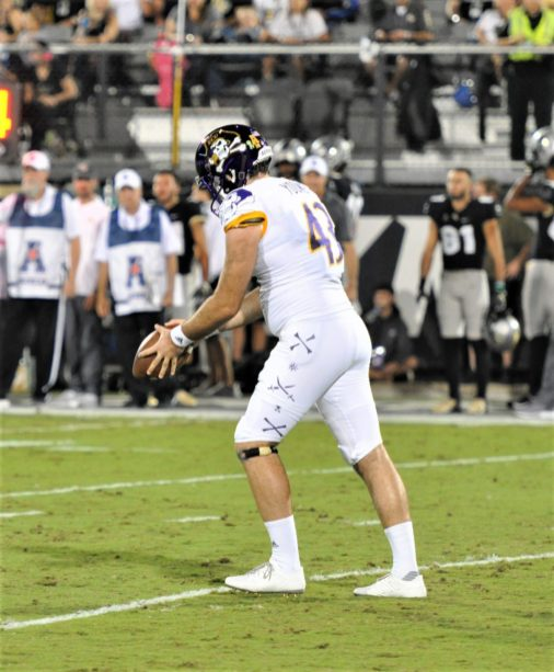 Punter Jonn Young prepares to send the pigskin downfield at Spectrum Stadium (Al Myatt photo)