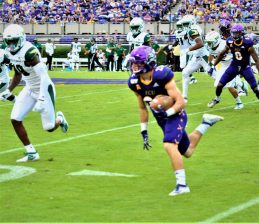 Tyler Snead returns a kickoff for the Pirates. Snead took the opening kickoff 100 yards for a touchdown. (Photo by Al Myatt)