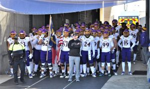 ECU coach Mike Houston and the Pirates wait in the tunnel to take the field at Connecticut. (Photo by Al Myatt.)