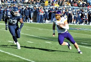 Sophomore quarterback Holton Ahlers runs the ball on Saturday for East Carolina. (Photo by Al Myatt)
