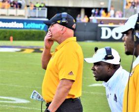 ECU coach Mike Houston ponders the action on Bagwell Field. (Al Myatt photo)