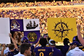 The Pirates are using placards with symbols to send in plays. (Al Myatt photo)