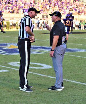 East Carolina coach Mike Houston wants an explanation on an offensive pass interference call. (Al Myatt photo)