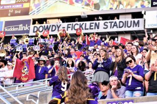 The student section, the Boneyard, is energized with the Pirates driving on the East end of Dowdy-Ficklen Stadium. (Al Myatt photo)