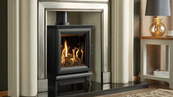 The Gazco Sheraton 5 gas stove in a surround in black