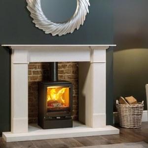 stovax vogue midi woodburning with plinth and claremont limestone mantel mi 1