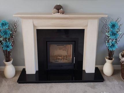 Fireline FPi5W Wood Burning Fire with a limestone surround