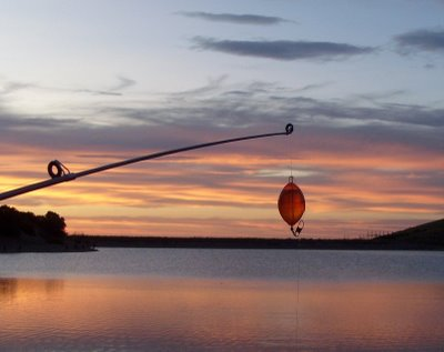 Rod and (standard size) fly-casting bubble against the sunset over Settlement Canyon Reservoir (photo by Clint Thomsen)