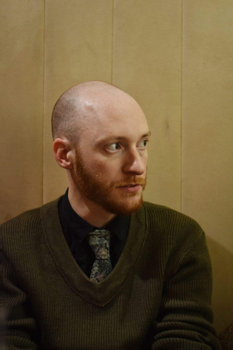 Portrait d'Elric Dufau en vert - Photo Alain François