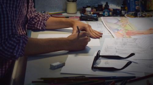 Jackson Rees à sa table de travail - Photo Alain François
