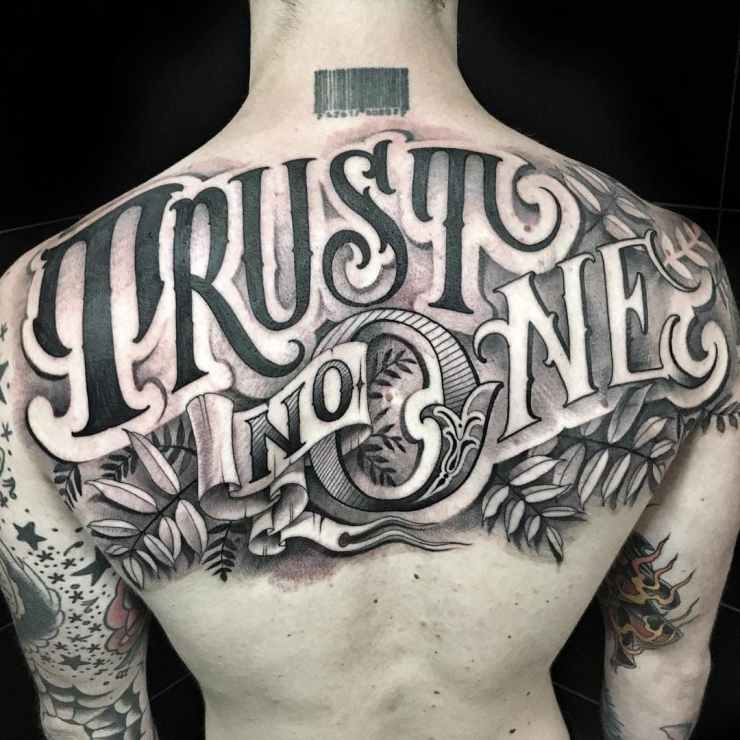 large lettering tattoo