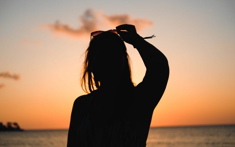 silhouette of woman at beacnh