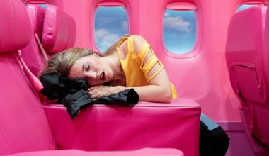 girl in yellow long sleeve shirt lying on red inflatable bed