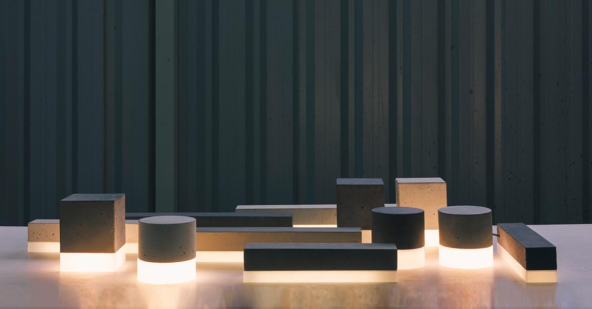 Tomada: design de luminárias em concreto