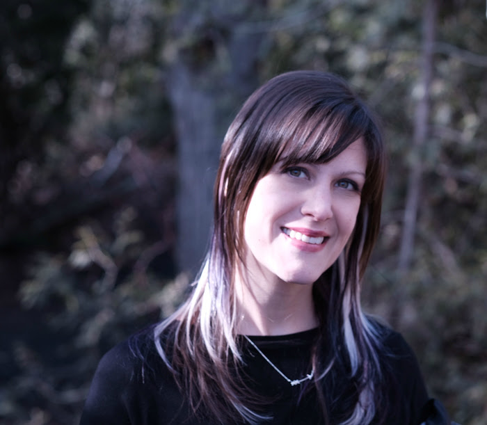 an author picture of Helena Hunting posed in front of trees