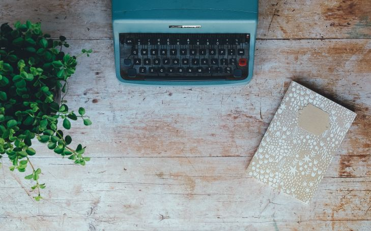 Typewriter and notebook stock image