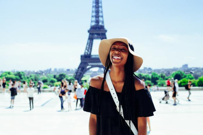 Black Young Woman Smiling at Eiffel Tower