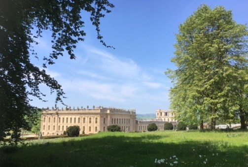 A grand view of Chatsworth House providing a wonderful background for some holiday reading