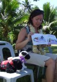 New Zealand author Victoria Jones celebrating International Book Giving Day by reading to kids.