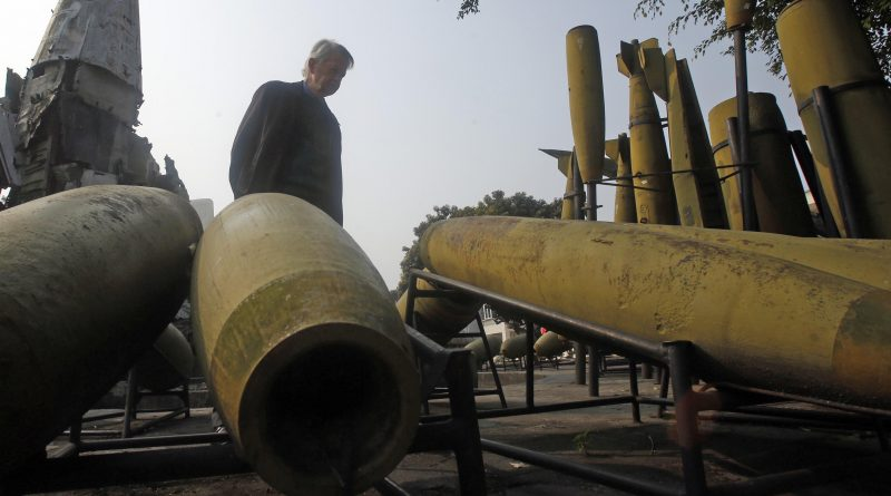 US' Vietnam War Veteran for Peace Vice President Chuck Searcy poses for a photo near shells of bombs which used by US airforce during Vietnam War, which displaying at the Army museum in Hanoi January 19, 2015. Photo by Peter Nguyen