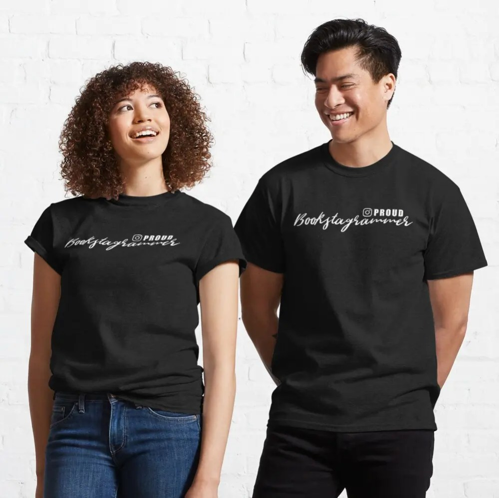 A man and a woman wearing a black t-shirt with bookstagrammer written on it