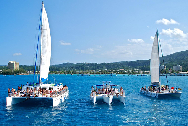 Dunn's River Falls by Catamaran Party Cruise | Book Jamaica Excursions | bookjamaicaexcursions.com | Karandas Tours
