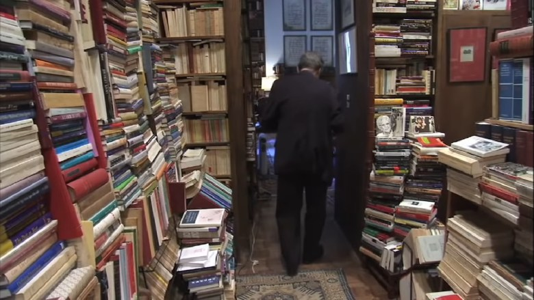 Prof Macksey in his personal library