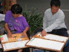 Продавцы лотерейных билетов в Таиланде