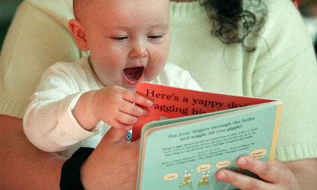 Baby reading with mum