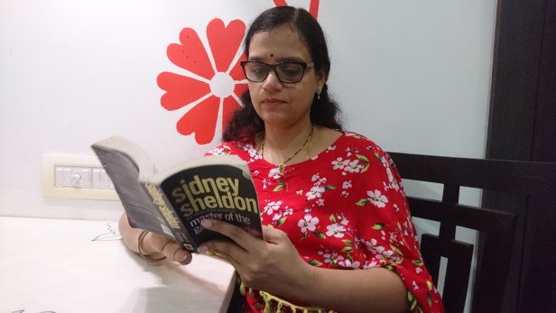 Praveena reading Sidney Sheldon