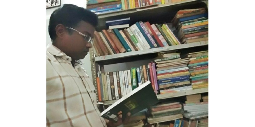 Ravi with his vast collection of books