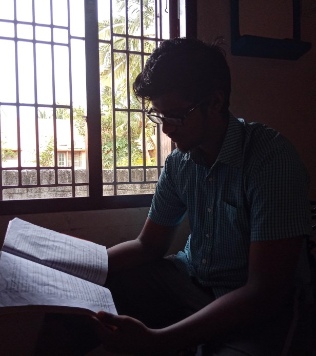 Bala engrossed in reading a book