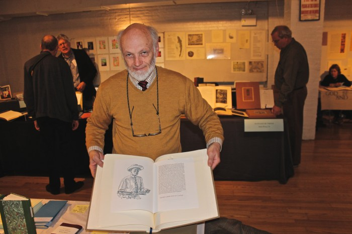 Graham Moss of Incline Press holding 'E.R. Weiss: The Typography of an Artist'