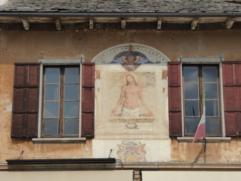 Ochre house with painted fresco