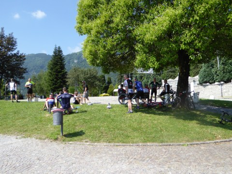 Cyclists refuel and exchange pleasantries on the small lawn