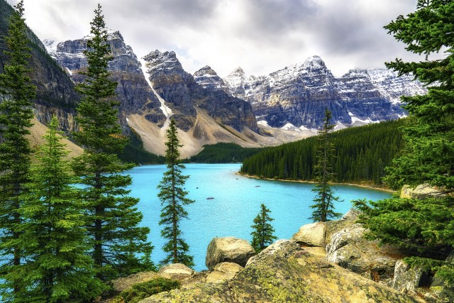 Children's Books About the United States - Picture of beautiful blue lake in a forest with mountains - Children's Books About the 50 States