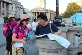 London Ambassador helping a tourist