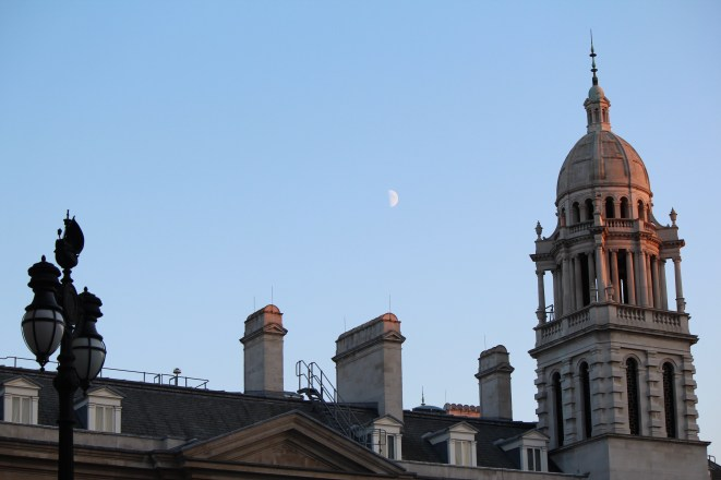 The moon over buildings in Spring Gardens