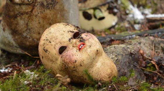 Doll's head on a trash heap
