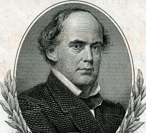 Name the man and the denomination of the US currency.