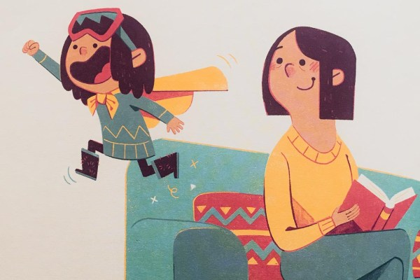 Little Nunavut girl with goggles & cape leaping off sofa as her smiling mother watches