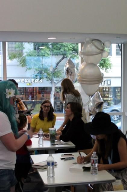 Kami Garcia ('Beautiful Creatures') signs books alongside her fellow authors.