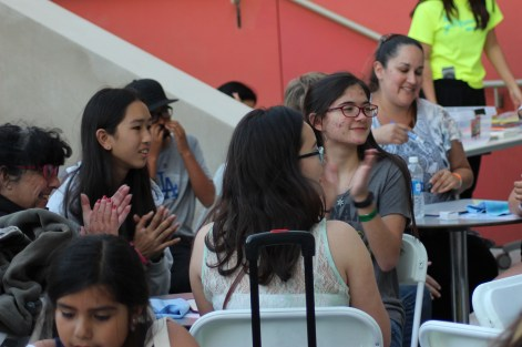 YALLWEST attendees participate in a game of trivia outside the library.