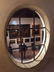 Looking through oval window into gallery at Rembrandt's house in Amsterdam