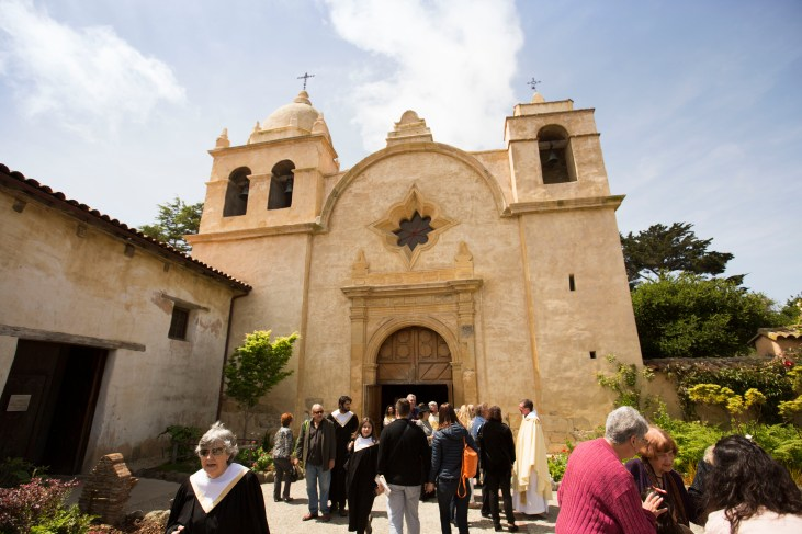 Members of the Mission San Carlos Borromeo de Carmelo parish congregate following a Sunday service. (Contemporary community consisting of wealthy white folks.)